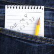 Notebook in jeans pocket - Stock Photo