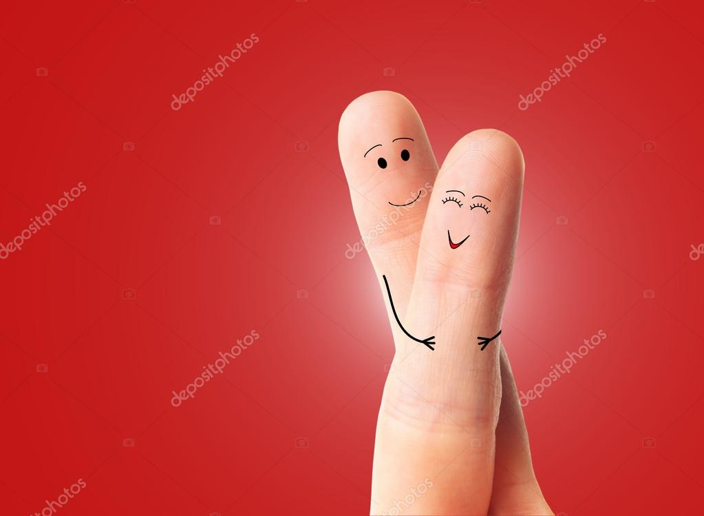 A happy couple in love in front of a red background  Foto Stock #13655622