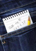 Notebook in jeans pocket — Stock Photo