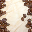 Coffee beans on paper — Stock fotografie