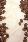 Coffee beans on paper — ストック写真