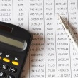 Stock Photo: Chart with calculator and pen