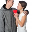 Young couple with red heart — Stock Photo