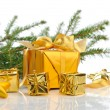 Golden Christmas gifts — Stock Photo