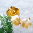 Gold  Christmas on snow - Stock Photo