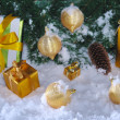 Golden Christmas on snow — Stockfoto