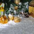 Golden Christmas on snow - Stock Photo