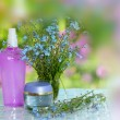 Royalty-Free Stock Photo: Cosmetics bottles with flowers