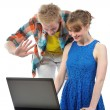 Young couple with laptop - Stock Photo