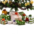 Stock Photo: Gift boxes under Christmas tree