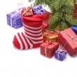 Santa stocking with gifts — Stock Photo #34742691