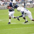 Penn State running back Silas Redd hits hole — Stock Photo #18243471