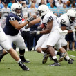 Penn State runningback hits hole — Stock Photo #18243717