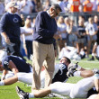 Penn State coach Joe Paterno looks down and points at a player — Stock Photo