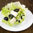 Tasty salad with camembert cheese — Stock Photo