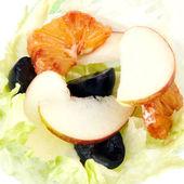 Fruit salad in lettuce leaf — Stock Photo