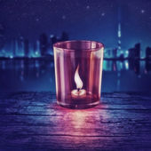 Light a candle in the city — Stock Photo