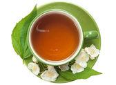 Cup of jasmin tea — Stock Photo