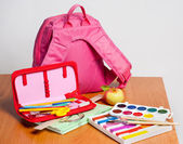 Portfolio and school supplies — Stock Photo