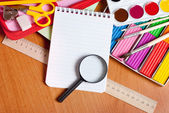 Notepads, and a magnifying glass — Stock Photo