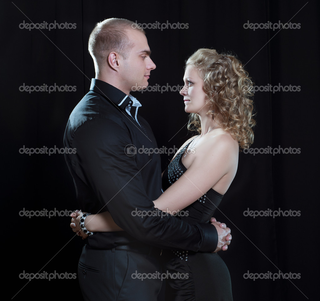 Young couple in elegant evening dresses — Stock Photo #14069414