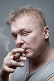 Men smoking cigar — Stock Photo