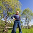Boy stands on the grass — Stockfoto