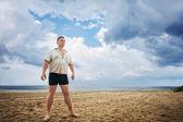 A man on the beach — Stock Photo