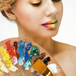 Girl with colored lips with palette — Stock Photo