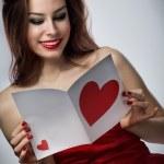 Girl reading a card — Stock Photo