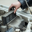 Stock Photo: Replacing the air filter