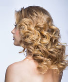 Blond girl with fluffy hair — Stock Photo