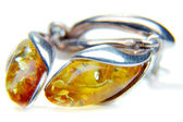 Amber ear rings — Stock Photo