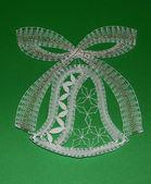 Make bobbin lace christmas bell — Stock Photo