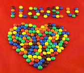Heart made from chocolate lentils — Stock Photo