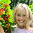 Little girl with red currant — Stock Photo