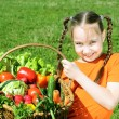 Girl with basket of vegetables - Stock Photo
