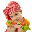 Little girl eating sandwich — Stock Photo