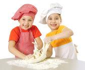 Messy children kneading — Stock Photo