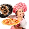 Stock Photo: Young girl preparing homemade pizza