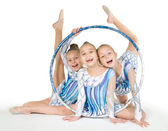 Little beautiful gymnasts with the hoop — Stock Photo