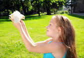 Happy little girl with a small chicken — Stock Photo