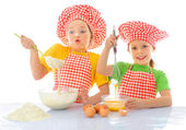 Little messy bakers — Stock Photo