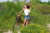 Beautiful girl with bicycle — Stock Photo