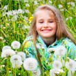 Little girl and yellow dandelion — Stock Photo