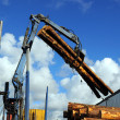 Truck crane loading timber - Stock Photo