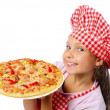 Stock Photo: Little girl preparing pizza