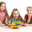 Stock Photo: Girls playing with constructor