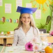 schoolgirl in classroom — Stock Photo