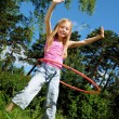 Stock Photo: Little girl with hulhoop